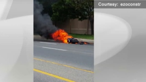 A burning motorcycle lies in the road after crashing near Dundas Street and Cedarglen Gate in Mississauga Sunday September 11, 2016. (Submitted)