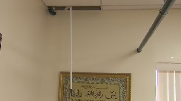 A broomstick is seen pointing from the ceiling of a mosque in Mississauga that was broken into overnight. (CTV Toronto)