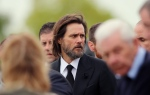 Actor Jim Carrey, centre, joins mourners as they walk behind the coffin of his ex-girlfriend Cathriona White to Our Lady of Fatima Church, in her home village of Cappawhite, Co Tipperary, Ireland, ahead of her funeral, Saturday Oct. 10, 2015. ( Niall Carson/PA via AP)
