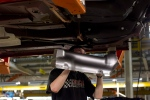 An assembly line worker at the General Motors Assembly plant in Oshawa works on a car on Friday December 16, 2011. THE CANADIAN PRESS/Chris Young