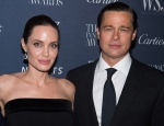 In this Nov. 4, 2015 file photo Angelina Jolie Pitt and Brad Pitt attend the WSJ Magazine Innovator Awards 2015 at The Museum of Modern Art in New York.  (Photo by Charles Sykes/Invision/AP, File)