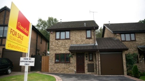 An exterior view shows the house for sale that starred onscreen as Harry Potter's childhood home in the town of Bracknell, England, just over 30 miles (50 kms) west of central London, Tuesday, Sept. 20, 2016.  Fans of the boy wizard will recognize it as the fictional address of 4 Privet Drive, home of Harry's dastardly aunt and uncle, the Dursleys, who made him sleep in a cupboard under the stairs. The 3-bedroom house is being sold by real estate agent Chancellors with an asking price of 475,000 pounds ($616,000). (AP Photo/Matt Dunham)