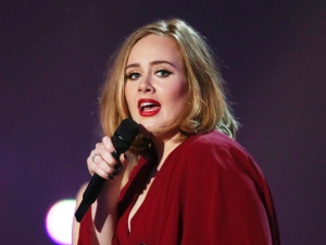 In this Feb. 24, 2016 file photo shows Adele onstage at the Brit Awards 2016 at the 02 Arena in London. (Photo by Joel Ryan/Invision/AP)