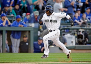 Seattle Mariners' Guillermo Heredia races home on a sacrifice fly by Robinson Cano against the Toronto Blue Jays in the 12th inning of a baseball game on Wednesday, Sept. 21, 2016, in Seattle. (AP Photo/Elaine Thompson)