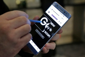 In this July 28, 2016, file photo, a screen magnification feature of the Samsung Galaxy Note 7 is demonstrated, in New York. (AP Photo/Richard Drew, File)