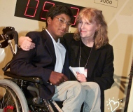 In this Sept. 27, 2000 file photo, actress Mia Farrow poses with her adopted son Thaddeus as they participate in the global summit on polio eradication at United Nations headquarters. (AP Photo/Richard Drew)