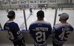 A trio of fans watch as the Toronto Maple Leafs' conduct their training camp at the BMO Centre in Halifax, N.S., on Friday, Sept. 23, 2016. (The Canadian Press/stringer)