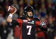 Ottawa Redblacks quarterback Trevor Harris (7) throws the ball against the Toronto Argonauts during first half CFL action on Friday, Sept. 23, 2016 in Ottawa. (The Canadian Press/Justin Tang)