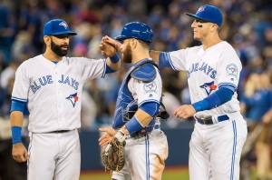 Toronto Blue Jays, left to right, Jose Bautista, Russell Martin, and Troy Tulowitzki celebrate their team's win against the New York Yankees in MLB baseball action in Toronto on Friday, Sept. 23, 2016. (The Canadian Press/Mark Blinch)