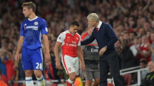 Manager Arsene Wenger of Arsenal pats Alexis Sanchez of Arsenal on the back as he leaves the game during the Premier League match between Arsenal and Chelsea played at the Emirates Stadium, London on 24th September 2016. (Joe Toth/BPI/REX/Shutterstock)