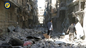 In this photo provided by the Syrian Civil Defense group known as the White Helmets, shows Syrian inspect damaged buildings after airstrikes hit in Aleppo, Syria, Saturday, Sept. 24, 2016. Syrian government forces captured a rebel-held area on the edge of Aleppo on Saturday, tightening their siege on opposition-held neighborhoods in the northern city as an ongoing wave of airstrikes destroyed more buildings. (Syrian Civil Defense White Helmets via AP)