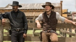 """In this image released by Sony Pictures, Chris Pratt, right, and Denzel Washington appear in a scene from """"The Magnificent Seven."""" Antoine Fuqua's """"The Magnificent Seven"""" remake rode the star power of Denzel Washington to an estimated $35 million debut, topping North American ticket sales over the weekend. (Sam Emerson/Sony Pictures via AP)"""
