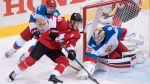 Team Canada centre Jonathan Toews (16) closes in on Team Russia goaltender Sergei Bobrovsky (72) under pressure from Team Russia centre Evgeny Kuznetsov (92) during first period semifinal World Cup of Hockey action in Toronto on Saturday, September 24, 2016. THE CANADIAN PRESS/Frank Gunn