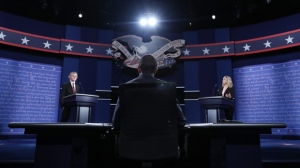 Students representing Donald Trump (L) and Hillary Clinton (R) and moderator Lester Holt (C) stand in position at the two podiums during a rehearsal the day before the first Presidential Debate at Hofstra University in Hempstead, New York, USA, 25 September 2016. The only Vice Presidential debate will be held on 04 October in Virginia, and the second and third Presidential Debates will be held on 09 October in Missouri and 19 October in Nevada.  EPA/ANDREW GOMBERT