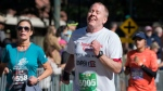 """Robert Schenk, of Brick N.J., nears the finish line during the """"Stephen Siller Tunnel to Towers"""" memorial event in New York, Sunday, Sept. 25 2016. The sponsors of the run honoring New York firefighter Stephen Siller, who died at the World Trade Center on Sept. 11, 2001, invited participants, including Schenk, of the Seaside, N.J., Semper Five Marine Corps charity run that was cancelled last week after a pipe bomb exploded along the route. (AP Photo/Craig Ruttle)"""
