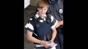 FILE - In this Thursday, June 18, 2015, file photo, Charleston, S.C., shooting suspect Dylann Roof is escorted from the Cleveland County Courthouse in Shelby, N.C. The first jurors report to the federal courthouse in Charleston, S.C., on Monday, Sept. 26, 2016 for jury screening in the federal death penalty case charging Roof with hate crimes and other charges. He is charged in the June, 17, 2015 slayings of nine people during a Bible study at Emanuel AME Church in Charleston. (AP Photo/Chuck Burton, File)