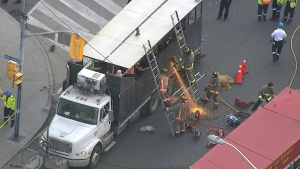 Paramedics say one person has been scalded by hot tar following a tar truck spill in the city's east end.