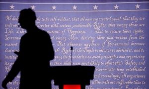 A producer walks past a podium on the stage for the presidential debate between Democratic presidential candidate Hillary Clinton and Republican presidential candidate Donald Trump at Hofstra University in Hempstead, N.Y., Monday, Sept. 26, 2016. (AP Photo/David Goldman)