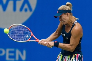 Angelique Kerber of Germany hits a return while playing against Kristina Mladenovic of France during the WTA Wuhan Open in Wuhan in central China's Hubei province Tuesday, Sept. 27, 2016. (Chinatopix via AP)