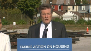 Mayor Tory speaks with reporters at a vacant lot on Lansdowne Avenue that is being set aside for future affordable housing development.