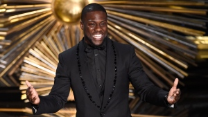 In this Feb. 28, 2016, file photo, Kevin Hart speaks at the Oscars at the Dolby Theatre in Los Angeles. Hart is literally laughing all the way to the bank. The funnyman tops the Forbes magazine list of the highest paid comedians with earnings of $87.5 million. The magazine compiled the estimated income from June 2015 and June 2016. (Photo by Chris Pizzello/Invision/AP, File)