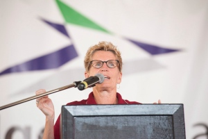 Ontario Premier Kathleen Wynne speaks at the opening ceremonies of International Plowing Match in Harriston, Ont. on Tuesday, Sept. 20, 2016. (The Canadian Press/Hannah Yoon)