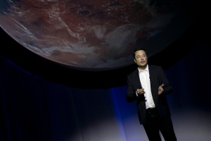 SpaceX founder Elon Musk speaks during the 67th International Astronautical Congress in Guadalajara, Mexico, Tuesday, Sept. 27, 2016.  (AP Photo/Refugio Ruiz)
