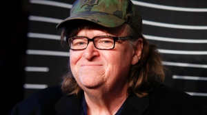 FILE - In this May 16, 2016 file photo, Michael Moore attends the 20th Annual Webby Awards at Cipriani Wall Street in New York. Moore says he's not allowed to perform a one-man show about the presidential race at a central Ohio theater because officials there consider him too controversial. Moore says he will go ahead with his plans for the show at an undisclosed site in southern Ohio in Oct. 2016. (Photo by Andy Kropa/Invision/AP, File)