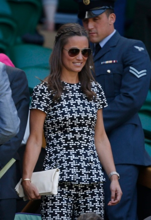 Pippa Middleton, the sister of Kate, the Duchess of Cambridge takes her seat in the Royal Box on Centre Court, ahead of the women's semifinal matches, at the All England Lawn Tennis Championships in Wimbledon, London, Thursday July 9, 2015. (AP Photo/Alastair Grant)