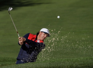 United States' Phil Mickelson hits from a bunker on the first hole during a practice round for the Ryder Cup golf tournament Tuesday, Sept. 27, 2016, at Hazeltine National Golf Club in Chaska, Minn. (AP Photo/David J. Phillip)
