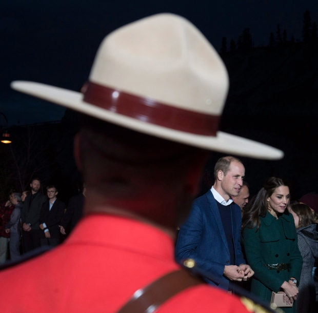 The Duke and Duchess of Cambridge walk past a member of the RCMP in Whitehorse, Yk., Tuesday, Sept 27, 2016. THE CANADIAN PRESS/Jonathan Hayward