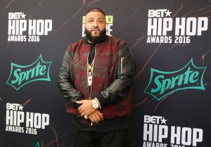 Hip-hop DJ Khaled poses for photographers as he arrives on the red carpet for the BET Hip Hop Awards in Atlanta on Saturday, Sept. 17, 2016. (AP Photo/Tami Chappell)