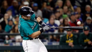Seattle Mariners' Jesus Montero grounds out to end the game against the Oakland Athletics in the ninth inning of a baseball game Friday, Oct. 2, 2015, in Seattle. (AP Photo/Elaine Thompson)