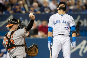 Toronto Blue Jays' Jose Bautista reacts to striking out against the Baltimore Orioles as Matt Wieters throws around the horn during the fourth inning of MLB baseball action in Toronto on Thursday, Sept. 29, 2016. (The Canadian Press/Mark Blinch)