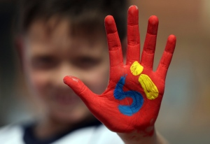 "A boy shows his hand painted with the word ""Yes"" in Spanish during an event attended by Colombia's President Juan Manuel Santos to promote the ""yes"" vote in the upcoming referendum on the peace deal he signed with rebels Revolutionary Armed Forces of Colombia, FARC, in Soacha, in the outskirts of Bogota, Colombia, on Friday, Sept. 30, 2016. (AP Photo/Fernando Vergara)"