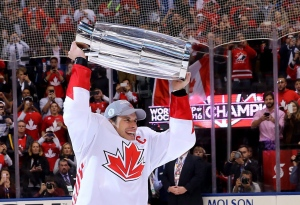 Team Canada's Sidney Crosby (87) hoists the trophy following his team's victory over Team Europe during World Cup of Hockey finals action in Toronto on Thursday, Sept. 29, 2016. (The Canadian Press/Bruce Bennett)