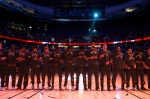 Toronto Raptors players lock arms during the singing of the national anthems before a pre-season NBA basketball game against the Golden State Warriors in Vancouver, B.C., on Saturday October 1, 2016. THE CANADIAN PRESS/Darryl Dyck