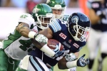 Saskatchewan Roughriders' Jeff Knox Jr. (49) tackles Toronto Argonauts' Vidal Hazelton (21) during first half CFL action in Toronto on Saturday Aug. 8, 2015. (The Canadian Press/Frank Gunn)