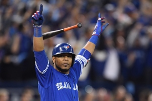 Toronto Blue Jays' Edwin Encarnacion celebrates after hitting a walk-off three-run home run during the 1th inning of the American League wild-card game against the Baltimore Orioles in Toronto on Tuesday, Oct. 4, 2016. (The Canadian Press/Frank Gunn)