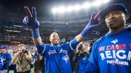 Toronto Blue Jays' Edwin Encarnacion celebrates his game winning walk-off three-run home run against the Baltimore Orioles with teammate Melvin Upton Jr. during 11th inning American League wild-card game action in Toronto, Tuesday, Oct.4, 2016. THE CANADIAN PRESS/Nathan Denette