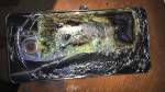 This Sunday, Oct. 9, 2016, photo shows a damaged Samsung Galaxy Note 7 on a table in Richmond, Va., after it caught fire earlier in the day. (Source: Shawn L. Minter via AP)