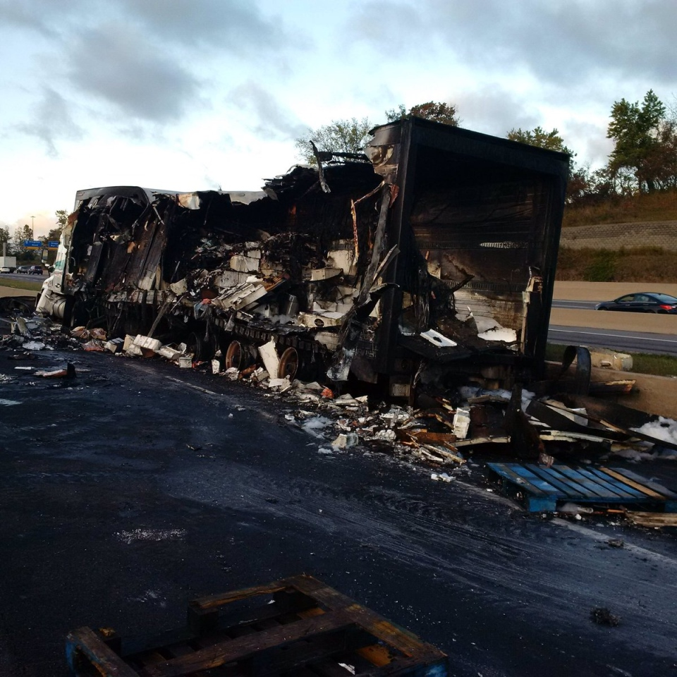 The remnants of a transport truck that crashed into a barrier and burst into flames on Hwy. 401 near Whites Road on Thursday is shown. (OPP)