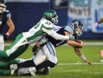 Toronto Argonauts quarterback Dan LeFevour is tackled by Saskatchewan Roughriders' A.C. Leonard during second half CFL action in Toronto, Saturday, October 15, 2016. THE CANADIAN PRESS/Frank Gunn