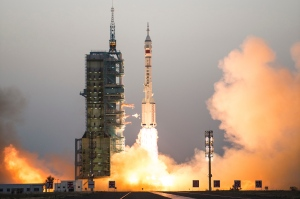 China's Shenzhou 11 spaceship onboard a Long March-2F carrier rocket takes off from the Jiuquan Satellite Launch Center in northwest China's Gansu province on Monday Oct. 17, 2016. (Chinatopix via AP)