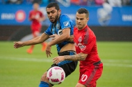 Montreal Impact's Victor Cabrera, left, challenges Toronto FC's Sebastian Giovinco during first half MLS soccer action in Montreal, Sunday, October 16, 2016. THE CANADIAN PRESS/Graham Hughes