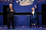 """In this Oct. 15, 2016 photo provided by NBC, Alec Baldwin, left, as Republican presidential candidate, Donald Trump, and Kate McKinnon, as Democratic presidential candidate, Hillary Clinton, perform during the during the """"Debate Cold Open"""" sketch.  (Will Heath/NBC via AP)"""