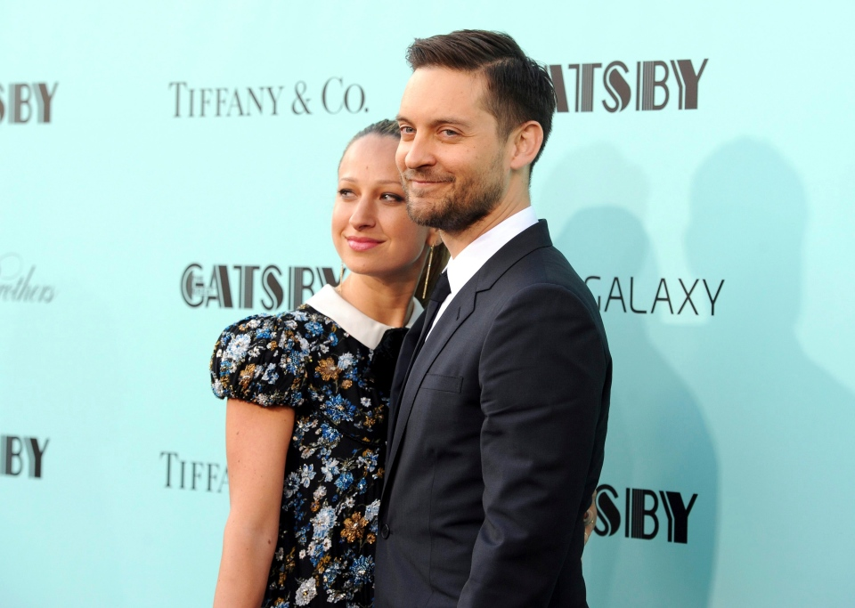 "In this May 1, 2013, file photo, actor Tobey Maguire, right, and wife Jennifer Meyer attend ""The Great Gatsby"" world premiere in New York. (Photo by Evan Agostini/Invision/AP)"