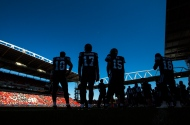 Players stand on the sidelines as the Toronto Argonauts play the Hamilton Tiger-Cats at BMO Field in Toronto on Saturday, June 11, 2016. (The Canadian Press/Mark Blinch)