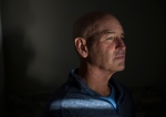 Terry Patterson, 52, sits in his home in Waterloo, Ont. on Friday, Oct. 14, 2016. Patterson was 49 when he was diagnosed with a tumour on his tonsil caused by HPV. He is advocating for young people to get vaccinated against the virus. THE CANADIAN PRESS/Hannah Yoon