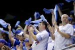 Fans cheer before Game 5 of baseball's American League Championship Series between the Cleveland Indians and the Toronto Blue Jays in Toronto on Wednesday, Oct. 18, 2016. (AP Photo/Charlie Riedel)